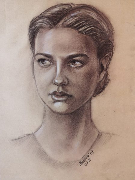 Portrait of a nice young girl drawn by sepia on craft paper