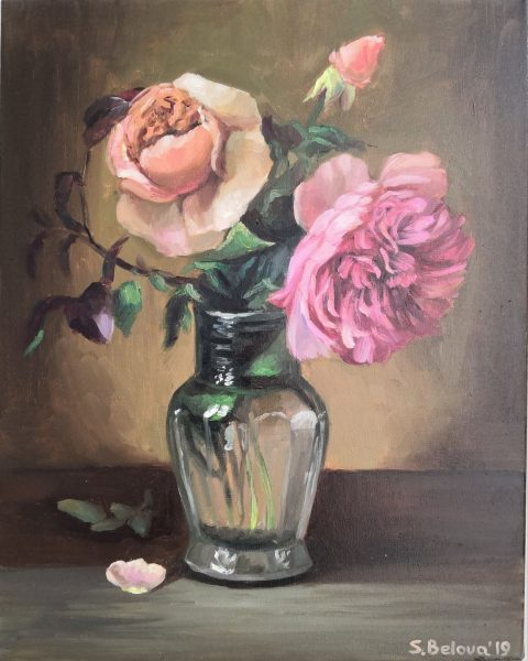 Painted pink roses in a glass vase