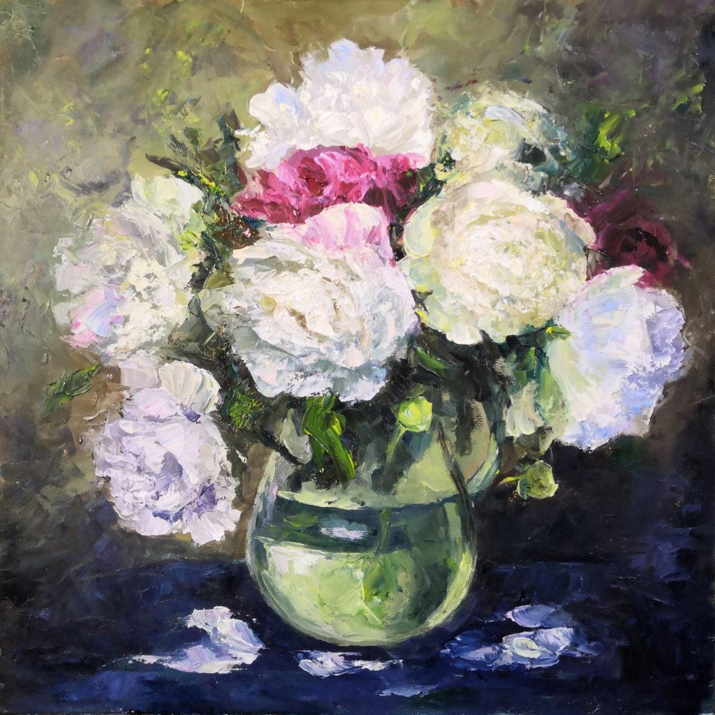 peonies in a glass vase